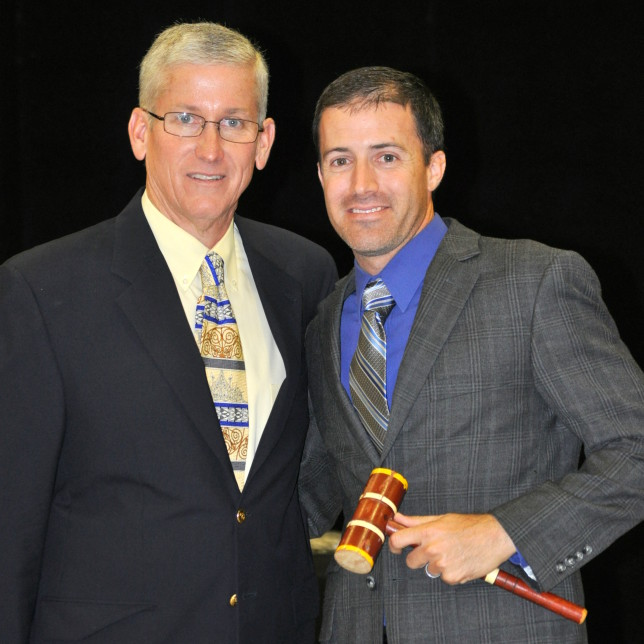 Charlie Taylor passes the gavel to Clint Culverhouse.